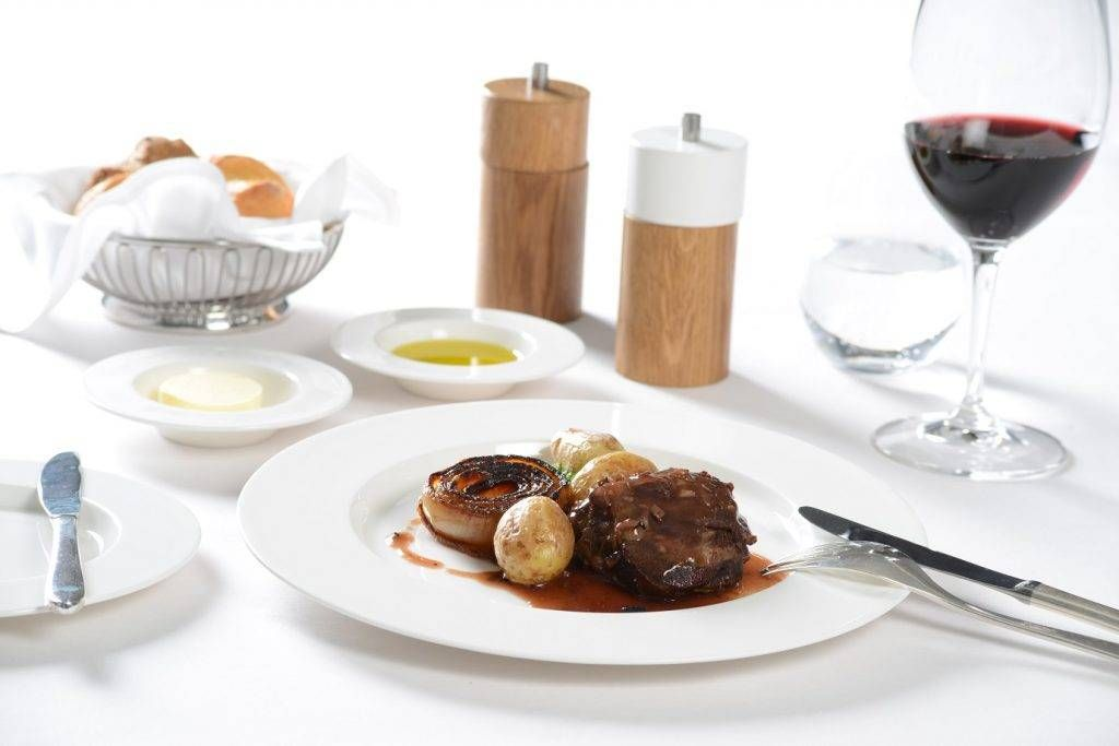 first_braised-veal-cheek-with-truffle-sauce-smoked-potatoes-kale-and-caramilsed-onion